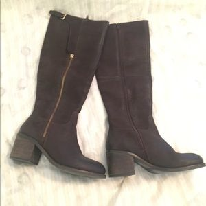 Steve Madden tall brown boots with block heel.